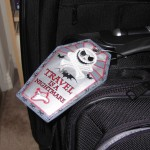 """The Nightmare Before Christmas"" Luggage Tag Attached to Suit Case"